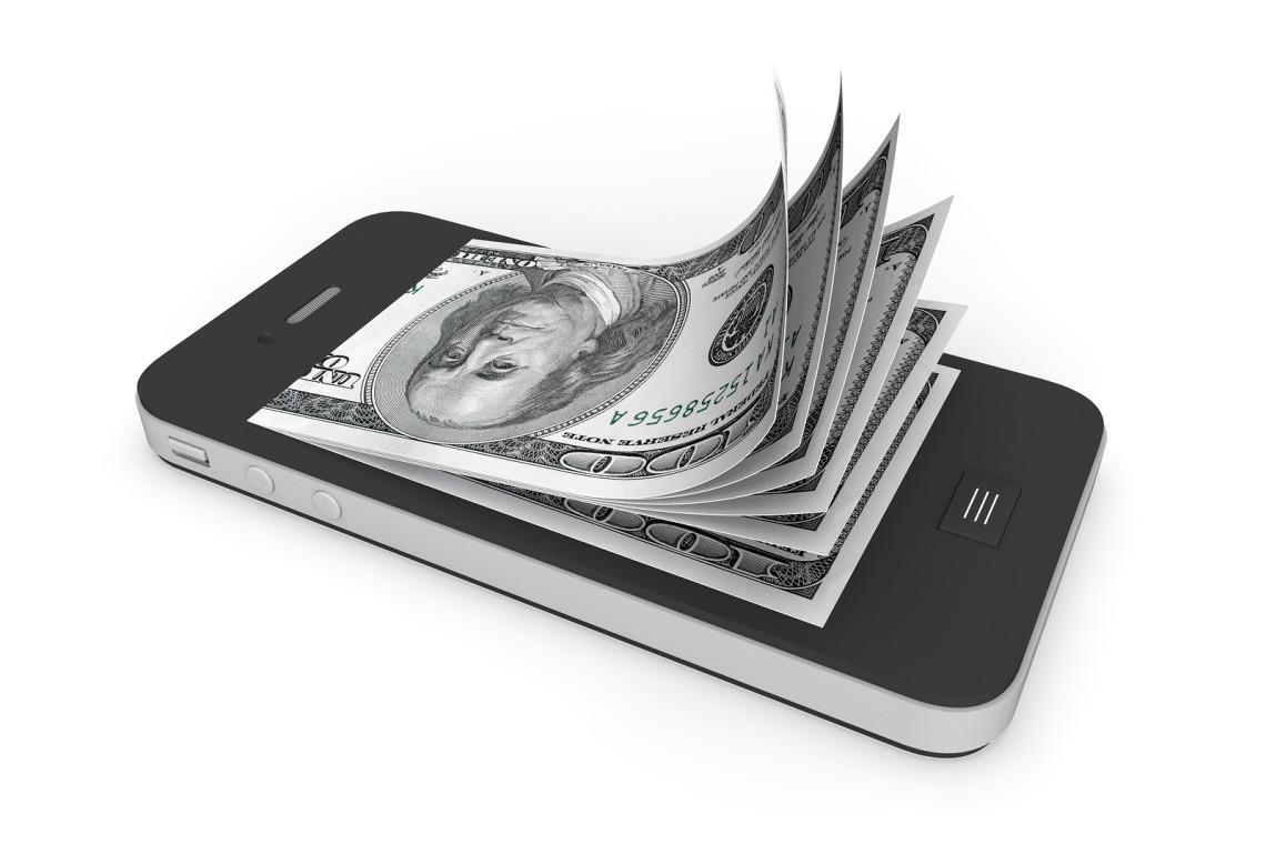 bigstock-Money-In-Mobile-Phone-39858736