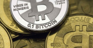 Some of Bitcoin enthusiast Mike Caldwell's coins are pictured at his office in this photo illustration in Sandy, Utah, January 31, 2014. REUTERS/Jim Urquhart  REUTERS/Jim Urquhart   (UNITED STATES - Tags: BUSINESS)