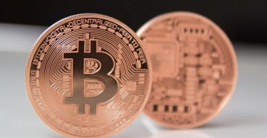 Aachen, Germany - Dec 02, 2013: Studioshot of 2 Bitcoins on white background.